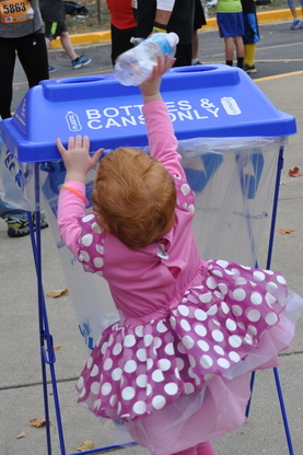 little girl participates in recycling